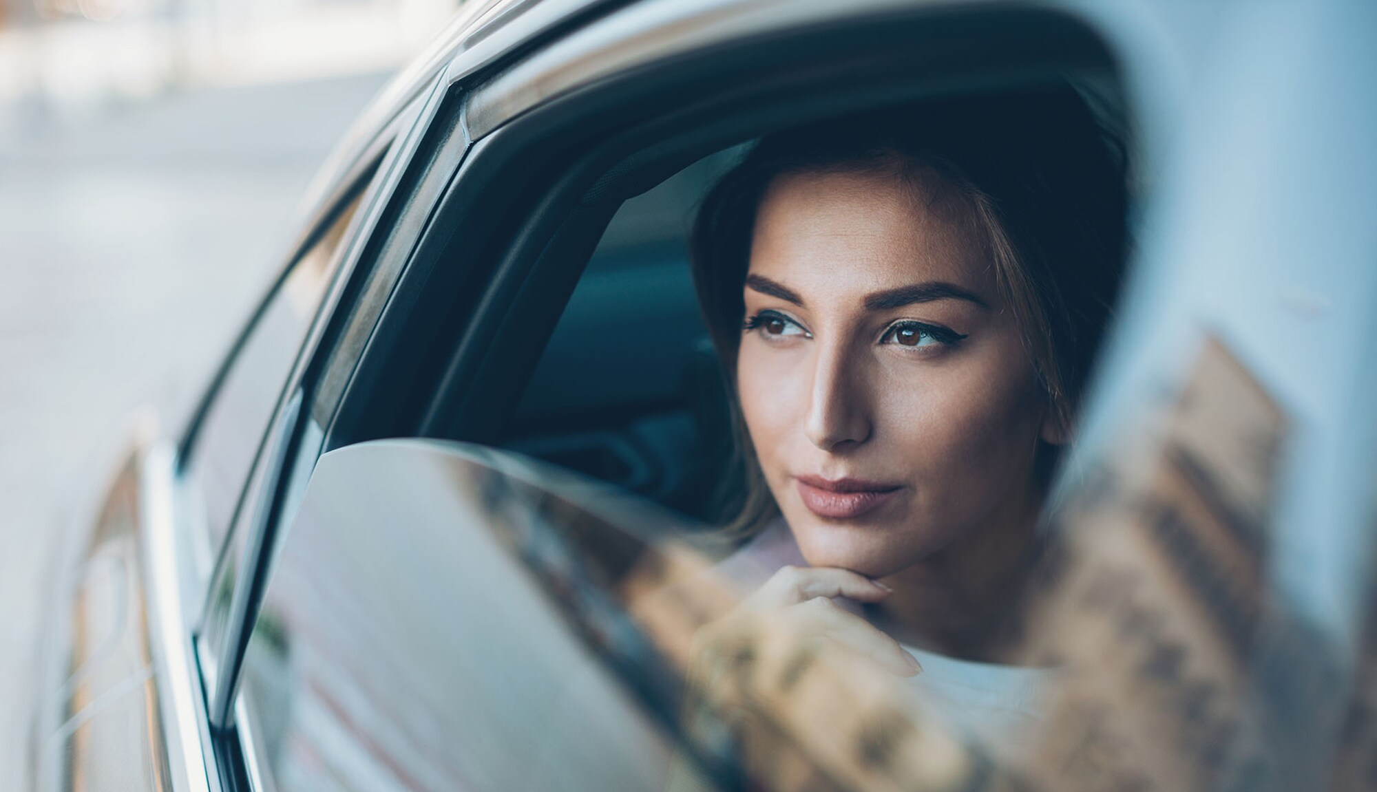 Rewards points – woman sightseeing in car.