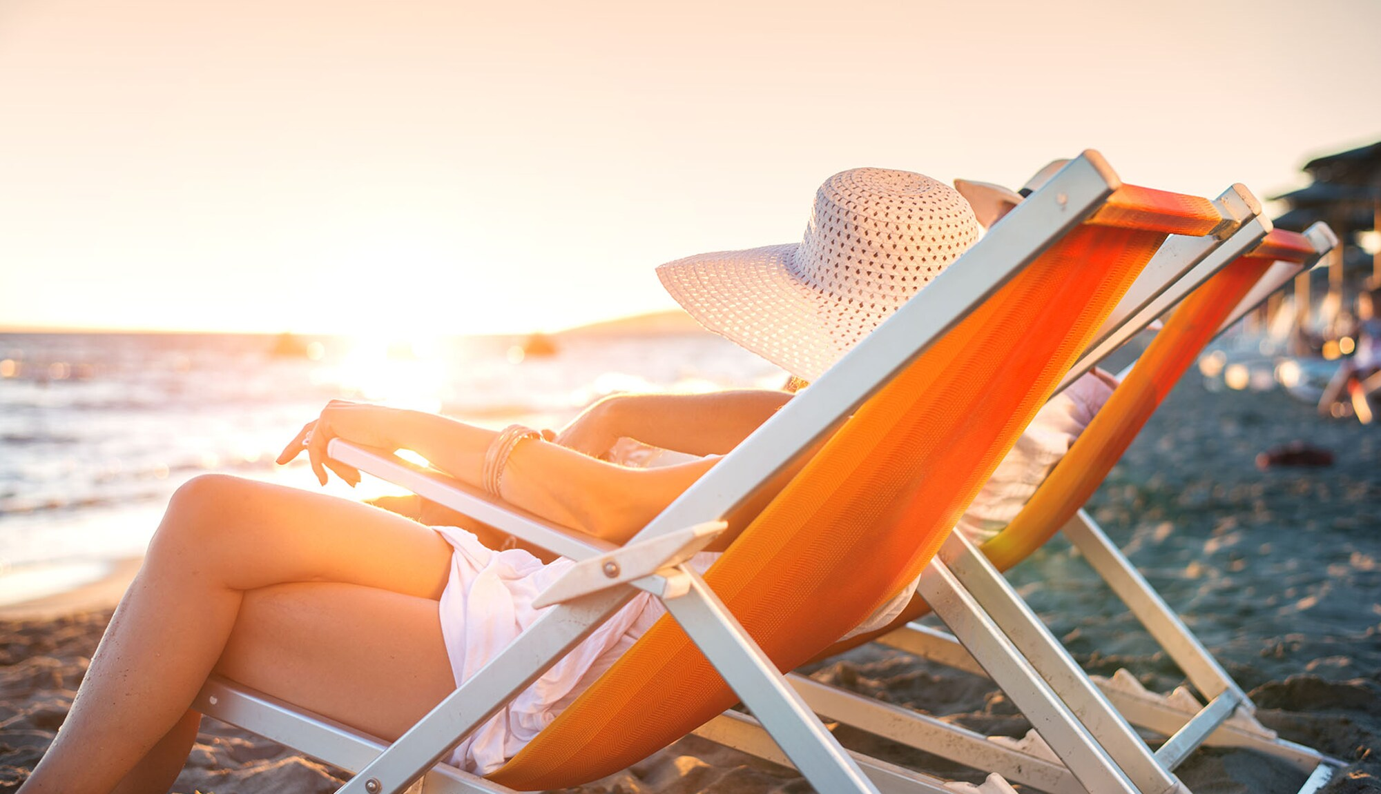 Complimentary Travel Insurance – woman in deck chair