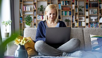 woman_using_laptop_at_home_on_lounge