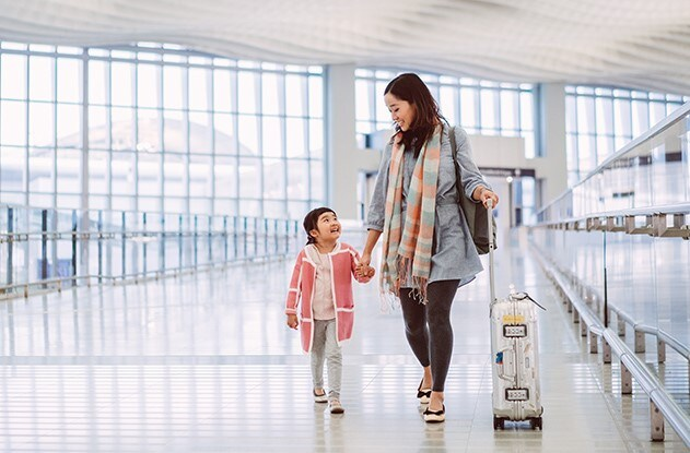 Mother and Daughter walking through airport