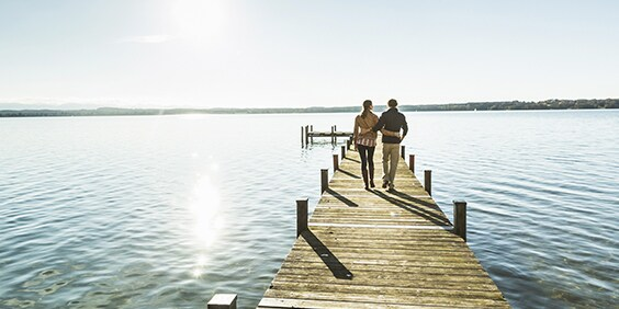 Couple walking on pier - American Express