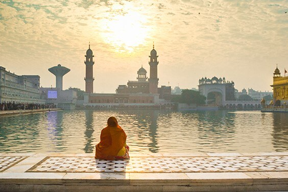 Woman admiring Golden Temple - American Express