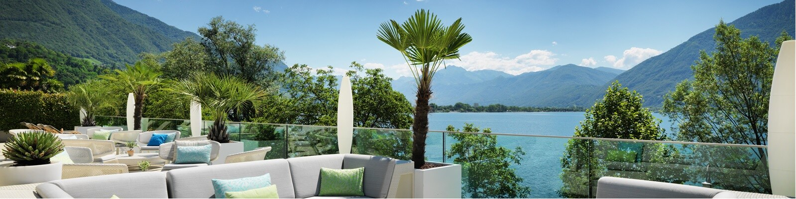 Image of lounge, overlooking lake and mountains