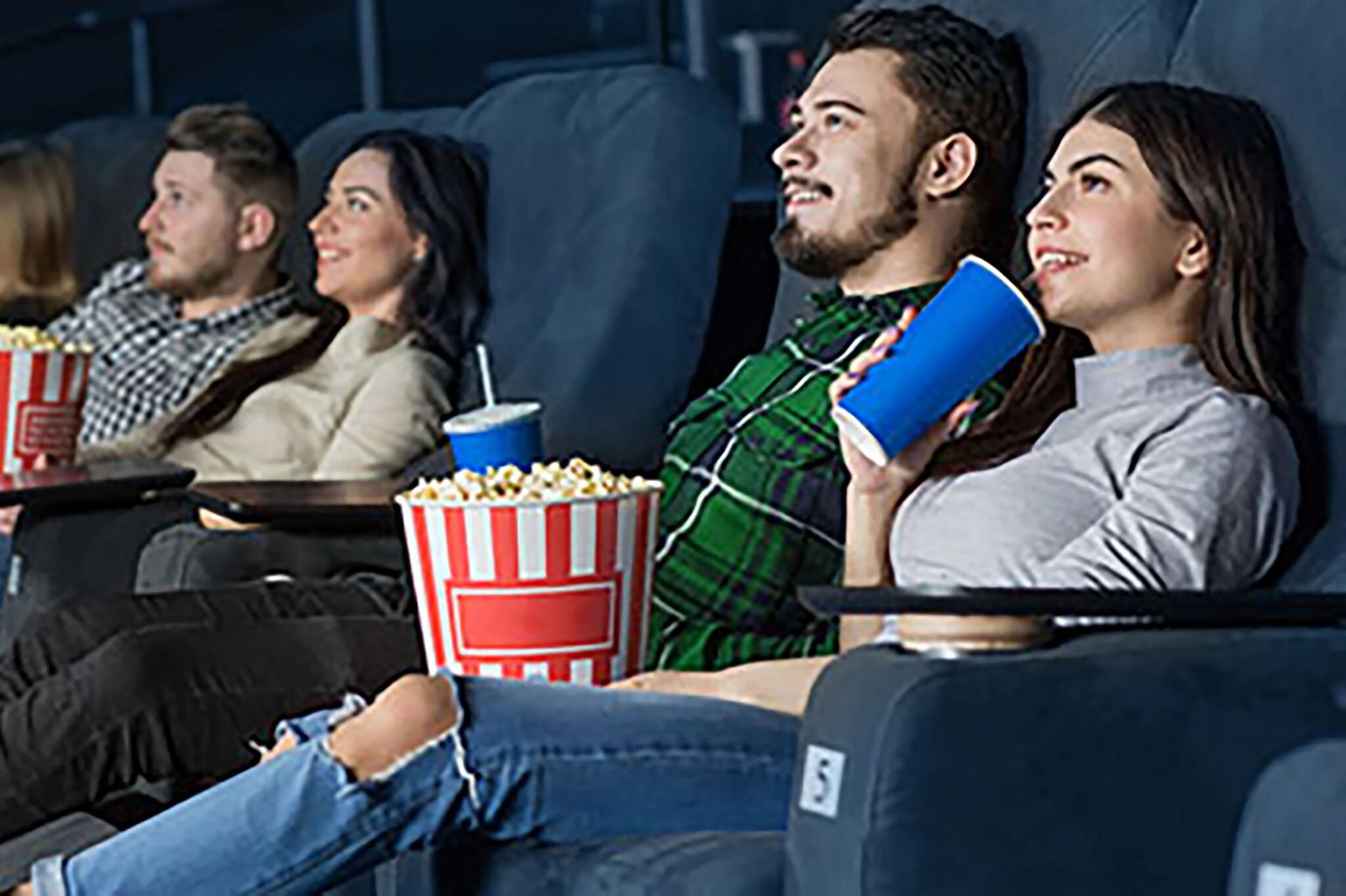 Couple laughing in movie theatre