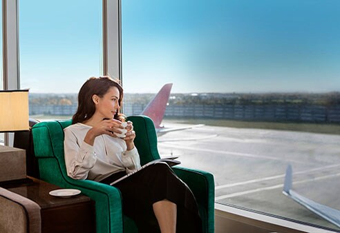 Woman sitting in airport lounge