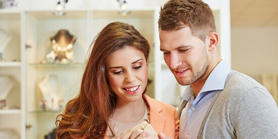Couple ring shopping in jewellery store