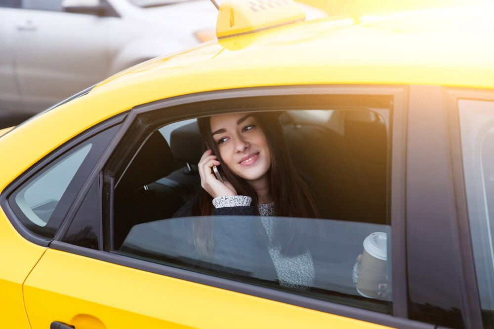 woman in taxi on phone