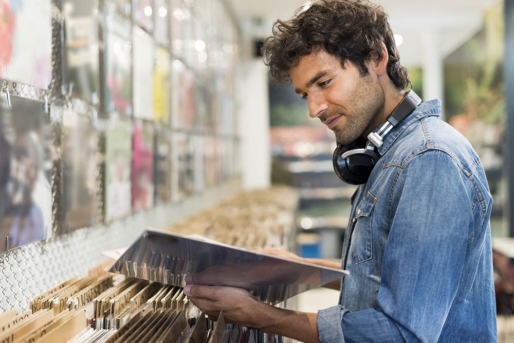 Man looking at records