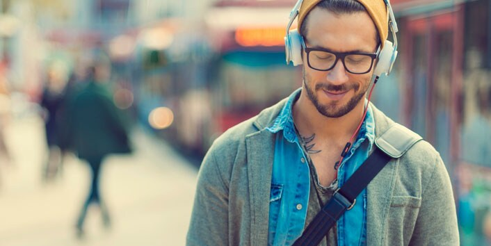 Man walking listening to music with headphones on