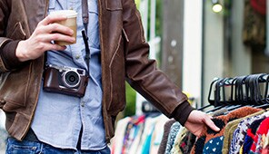 Man shopping with Camera around his neck