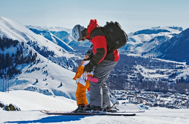 Image of a father and child skiing