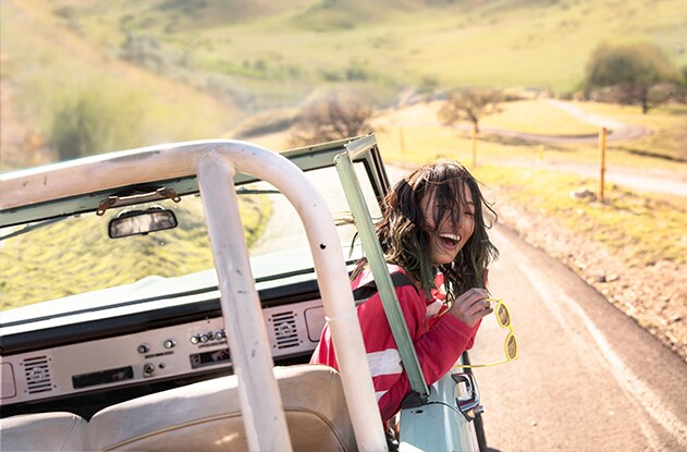 Image of a girl in a convertible car