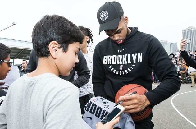 Basketball player signs autograph