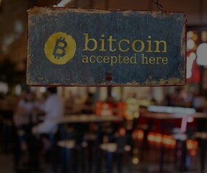 Some businesses have started to accept cryptocurrency payments through intermediaries to avoid volatility risk.