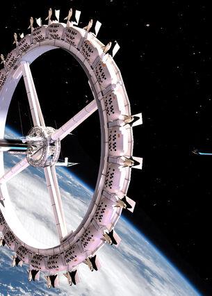 Ein ringförmiges Weltraumhotel schwebt über der Erde